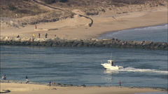 AERIAL United States-Fishing Boat Entering Indian River Inlet Stock Footage