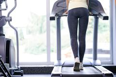 Back view of a girl on treadmill Stock Photos
