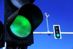Traffic lights over blue sky Stock Photos
