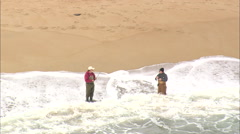 AERIAL United States-Fishermen On The Beach At Buxton Stock Footage