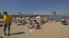Tourists on the beach in Barcelona Stock Footage