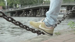 Men's leg shakes chain. Stock Footage