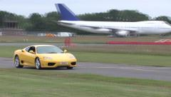 Yellow Ferrari on track Stock Footage