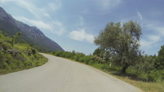 POV of a driving car on a curved raod in the mountains in Greece Stock Footage