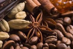 aroma coffe. ingredients. coffe beens, anise, chocolate, cardamon, cinnamon, sug - stock photo