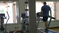 Working out on treadmill in modern gym Stock Footage
