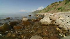 Wild stone beach on the southern coast of Crimea Stock Footage