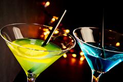 Cocktail drink on a disco bar table, club atmosphere Stock Photos