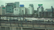 Stock Video Footage of Passing Thru Japanese City On Fast High Speed Bullet Train