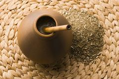 argentinian calabash with yerba mate - stock photo