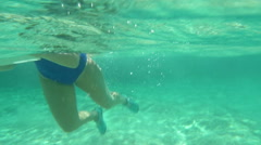 Woman using pad to make underwater shot Stock Footage