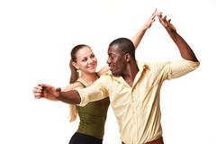 Young couple dances Caribbean Salsa, studio shot - stock photo