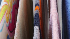 Colorful towels drying on the clothes line closeup Stock Footage