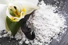 vanilla beans with aromatic sugar and flower - stock photo