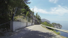 POV of a driving car on a road at the coast in Greece Stock Footage