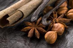 Aromatic spices with brown sugar and nuts Stock Photos