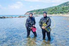Female Scuba Divers - stock photo