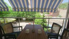 Stock Video Footage of Terrace under folding awning in a sunny summer day