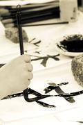 child drawing hieroglyph - stock photo