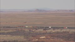 AERIAL United States-Freight Train Crossing The Petrified Forest National Park Stock Footage