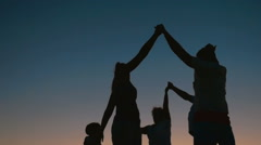Family Round Dancing at Night - stock footage