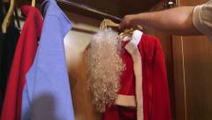 Santa Claus suit costume hanging in the wardrobe Stock Footage