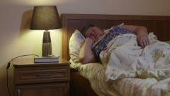 Overweight senior woman in bed at home talking on phone Arkistovideo