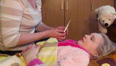 Mother at the bedside of a sick daughter - stock footage