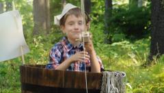 Little Boy Fishing in Woods in Barrel - stock footage