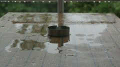 Stock Video Footage of Table with an ashtray in the rain