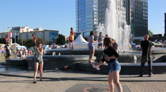 Teens spend their time in a fountain on a hot day Stock Footage