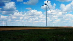 Wind Turbines With Goats, Goatherd Talking On The Mobile Phone, Zoom Out Stock Footage