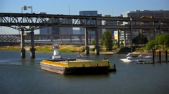 Barge Pushed Down Willamette River by Tugboat in Portland, Oregon Stock Footage