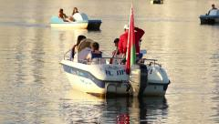 Motor boat starts to move, people sit on their seats in the boat Stock Footage