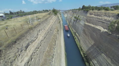 View from a bridge down to Corinth Canal with a passing ship Stock Footage