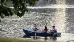Boat with people floating in the river Evening, boat trip Stock Footage