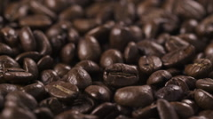Dark roasted coffee beans for espresso falling in slow motion Stock Footage