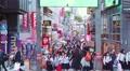 People walk and shop along the Takeshita Street in Harajuku, Tokyo, Japan Footage