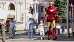 Live robot walks with the child in the city Stock Footage