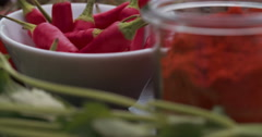 Stock Video Footage of Fresh chillies, paprika powder and herbs laid out attractively