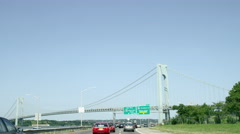 Famous Verrazano Bridge from road car driving toward Staten Island sign NYC 4K Stock Footage