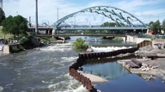 Stock Video Footage of High fast water in Platte River in Denver flooded jog path alternate