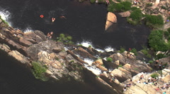 AERIAL Brazil-Man Under Waterfall With Pull Back North Of Belo Horizonte - stock footage