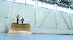 Girls Skate off with springboard Stock Footage