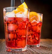 Spritz aperitif aperol cocktail glasses with orange slices and ice cubes Stock Photos