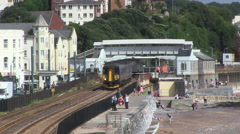 Train Leaving Dawlish Town Seafront Coastal Railway in South Devon Stock Footage