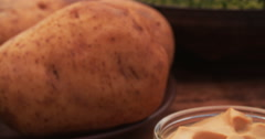Freshly baked potatoes on a vintage wooden table Stock Footage