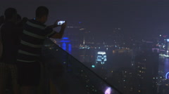 Rack focus of man taking photo of Hong Kong 4K Stock Footage