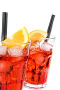 Two glasses of spritz aperitif aperol cocktail with orange slices and ice cub Stock Photos