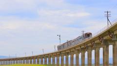 Thai trains running on bridge track Stock Footage